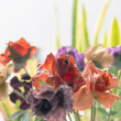 Close-up of artificial colorful flowers for interior decoration. — Stock Photo