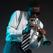 Retro african american jazz musician playing on his trumpet. Wea — Stock Photo