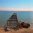 Panoramic shot of old pier at the beach. Blue sky. Long exposure — Stock fotografie #32663963