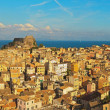 Panoramic shot of Corfu city with blue cloudy sky. Sen from abov — Stock Photo
