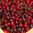 Red cherries in wooden crate. — Stock Photo
