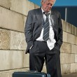 Depressed senior business man with suitcase without a job and ho — Stock Photo #34156313