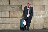 Lonely wandering depressed senior business man with sunglasses w — Stock Photo