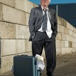 Depressed senior business man with suitcase without a job and ho — Stock Photo