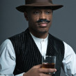 Vintage afro america western cowboy man with mustache. Drinking — Stock Photo
