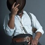 Sleeping retro afro america western cowboy man with mustache. Si — Stock Photo