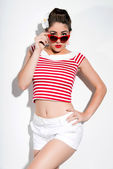 Sexy retro pin-up girl with sunglasses and red lipstick wearing — Stock Photo
