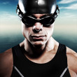 Triathlon swimmer man with cap and glasses outdoor at sea with b — Stock Photo #34887501