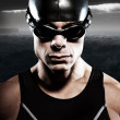 Triathlon swimmer man with cap and glasses outdoor at rough sea — Stock Photo #34887513