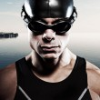 Triathlon swimmer man with cap and glasses outdoor at a lake wit — Stock Photo #34887519