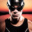 Triathlon swimmer man with cap and glasses outdoor at a lake at — Stock Photo #34887527