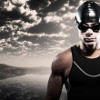 Swimmer triathlon man with cap and glasses outdoor at rough sea — Stock Photo