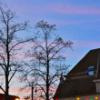 Houses and trees at sunset. Mechelen. Belgium. — Foto de Stock