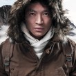 Asian winter sport fashion man with backpack in snow mountain la — Stock Photo #36520883