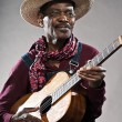 Retro senior afro american blues man in times of slavery. Wearin — Foto Stock