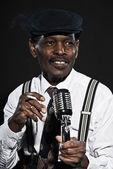 Singing retro senior afro american blues man. Wearing white shir — Stock Photo