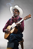 Retro senior afro american blues man in times of slavery. Wearin — Stock Photo