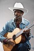 Retro senior afro american blues man in times of slavery. Wearin — Stock Photo