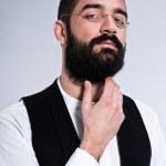 Retro hipster 1900 fashion man with black hair and beard. Wearin — Stock Photo