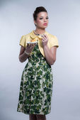 Retro fifties fashion brunette girl wearing green dress and yell — Stock Photo