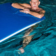 Stock Photo: Healthy active senior mwith beard in indoor swimming pool pla