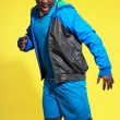 Screaming athletic black man in sportswear fashion. Runner with — Stock Photo