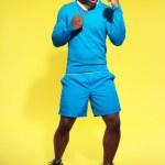 Athletic black man in sportswear fashion. Boxer. Intense colors. — Stock Photo #41667263