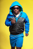 Athletic black man in sportswear fashion. Runner with hoody jack — Stock Photo
