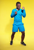 Athletic black man in sportswear fashion. Boxer. Intense colors. — Stock Photo