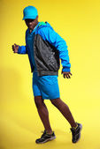 Athletic black man in sportswear fashion. Runner with jacket and — Stock Photo