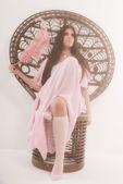 Sensual retro seventies fashion brunette girl sitting in big cha — Stock Photo