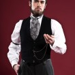 Retro 1900 victorian fashion man with beard wearing black gilet — Stock Photo #43056541