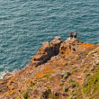Tourists walking on rocks near ocean. Top view. — Stock Photo #51186501
