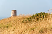 Long grass with old tower at the Cape of Frehel. Brittany. Franc — Stock Photo