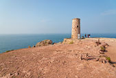 Cliffs with old tower at the Cape of Frehel. Brittany. France. — Stock Photo