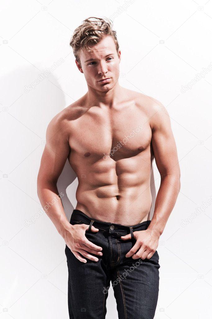 Male fitness model wearing blue jeans. Blonde hair ...