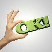 Hand is showing OK sign and hold 3D text — Stock Photo