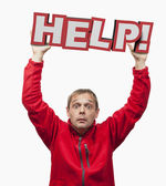 HELP icon. Amazed man holding 3d plate. — Stock Photo