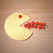 Conceptual pizza smile eat tomatoes — Stock Photo