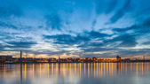 Evening cityscape with river — Stock Photo