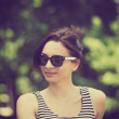 Stylized instagram colorized vintage fashion portrait of a young sexy woman wearing sunglasses with beauty bokeh — Stock Photo