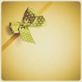 Shiny ribbon on vintage background — Stock Photo