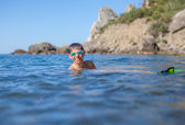 Boy swims in the sea — Stock Photo