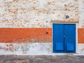 Old obsolete door and brick wall — Photo