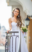 Beautiful bride outdoors in a city — Stock Photo