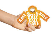Hand holding sale tag — Photo