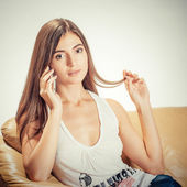 Young attractive woman talking on the telephone — Stock Photo
