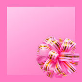 Gift bow on pink background — Stock Photo