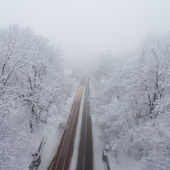 Snowstorm, slick roads and lots of traffic in city — Stock Photo