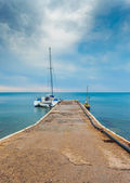 Seascape with boat and yacht — Stock Photo